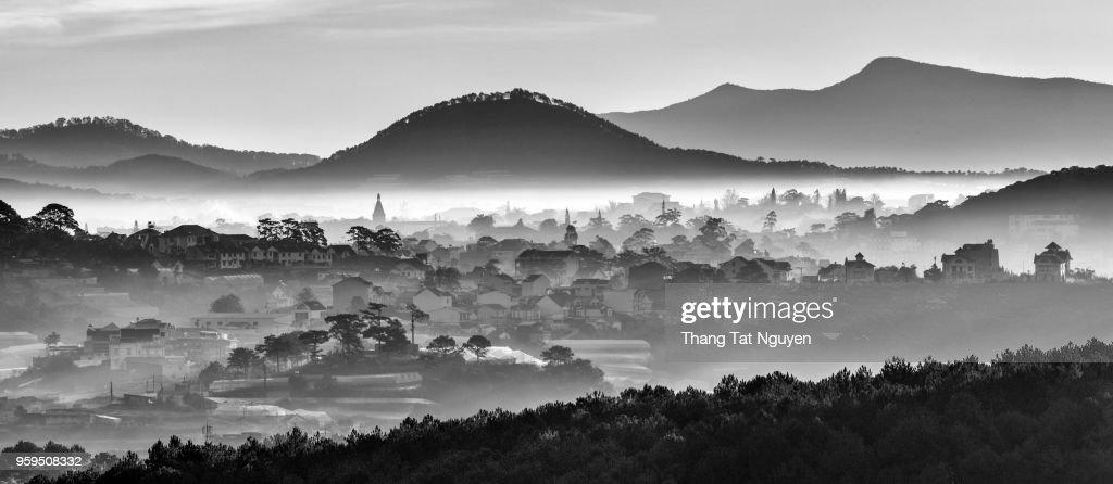Dalat City in mist  in black & white : Stock Photo