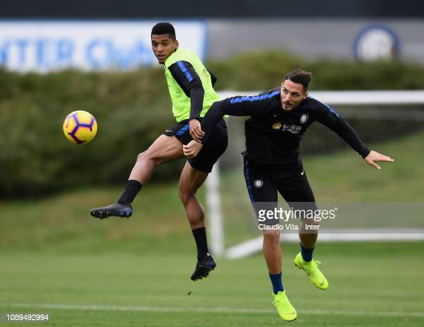 Dalbert Henrique Chagas Estevão and Danilo D'Ambrosio of FC Internazionale compete for the ball during a training session at the club's training...