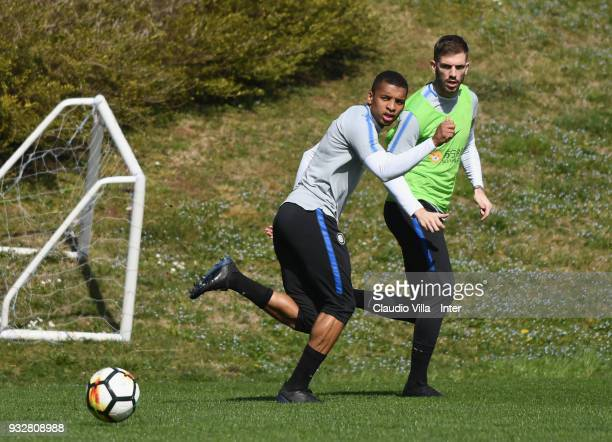 Dalbert Henrique Chagas Estevão and Davide Santon of FC Internazionale compete for the ball during the FC Internazionale training session at the...