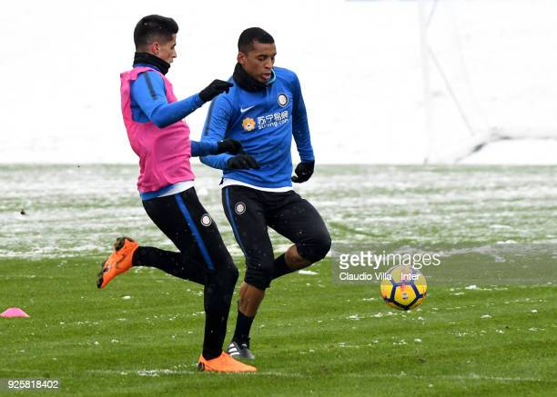 Dalbert Henrique Chagas Estevão and Joao Cancelo of FC Internazionale compete for the ball during the FC Internazionale training session at the...
