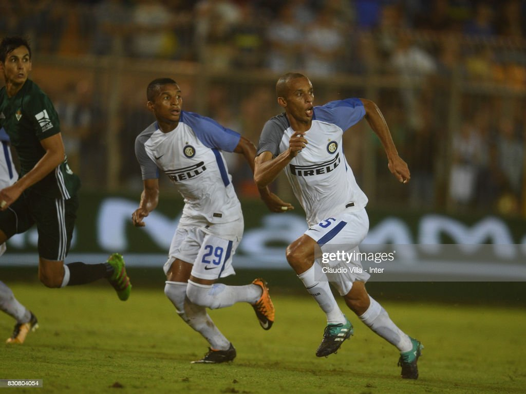 Dalbert Henrique Chagas Estevão and Joao Miranda de Souza Filho (R) of FC Internazionale in action during the Pre-Season Friendly match between FC Internazionale and Real Betis at Stadio Via del Mare on August 12, 2017 in Lecce, Italy.