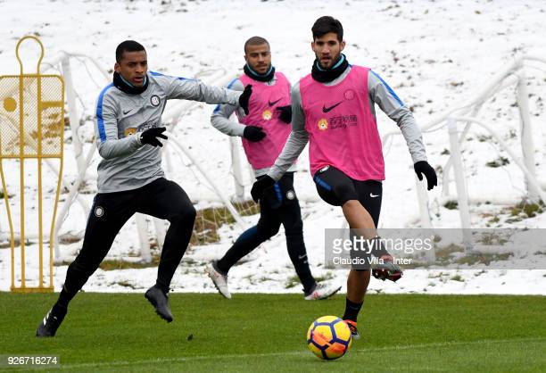 Dalbert Henrique Chagas Estevão and Lisandro Lopez of FC Internazionale compete for the ball during the FC Internazionale training session at the...