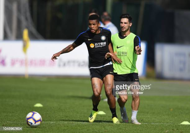 Dalbert Henrique Chagas Estevão and Matteo Politano of FC Internazionale compete for the ball during a training session at the club's training ground...