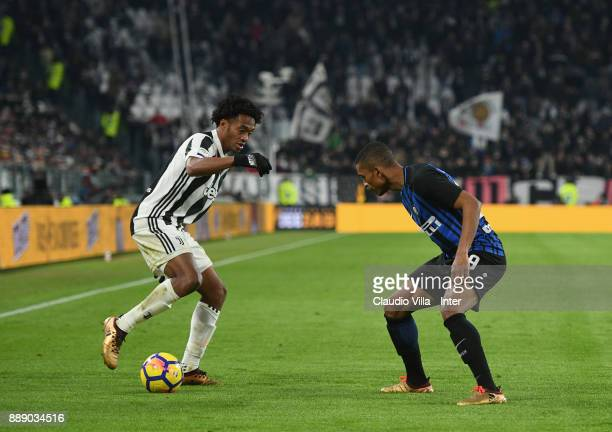 Dalbert Henrique Chagas Estevão of FC Internazionale and Juan Cuadrado of Juventus FC compete for the ball during the Serie A match between Juventus...