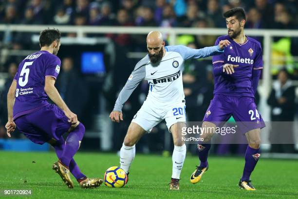 Dalbert of Internazionale between Milan Badelj and Marco Benassi of Fiorentina at Artemio Franchi Stadium in Florence Italy on January 5 2017