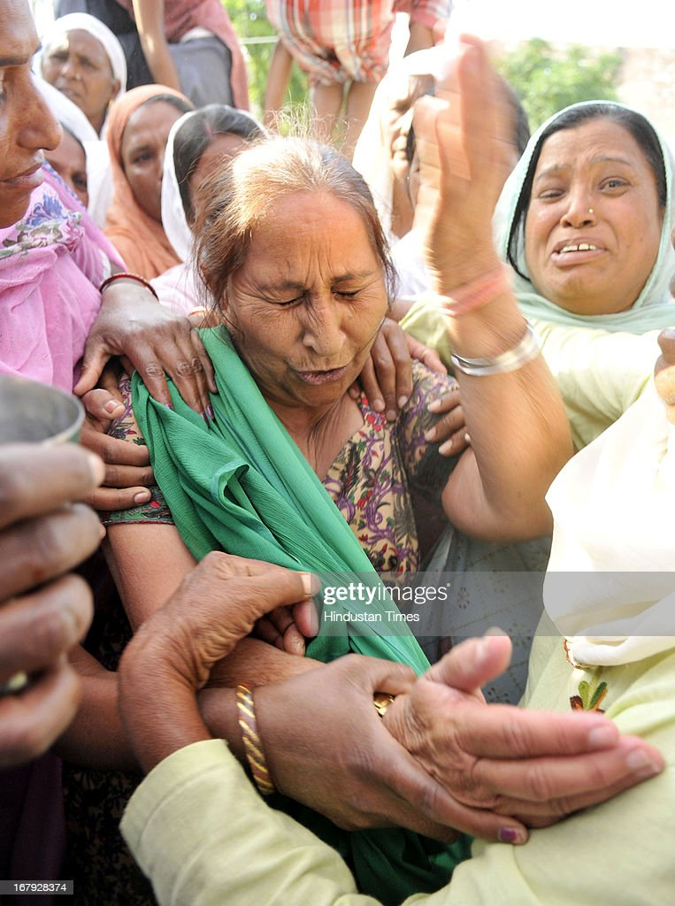 Dalbir Kaur, sister of Sarabjit Singh, an Indian prisoner in Pakistan who died in Pakistan hospital after being attacked by fellow inmates cries at their native house on May 2, 2013 in Bikhiwind about 40 Kms from Amritsar, India. Sarabjit was arrested in 1990 after bombings in Lahore and Faisalabad that killed 14 people and was convicted of spying and carrying out the bomb blasts. His family maintained Singh was innocent and had entered Pakistan inadvertently from his hometown of Bhikiwind in northern Punjab state bordering Pakistan.