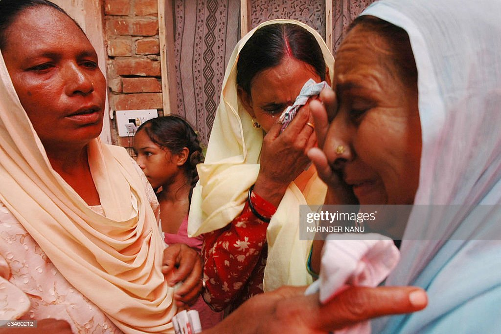 Dalbir Kaur the sister of imprisoned Sarabjit Singh and Sukhpreet Kaur the wife of Sarabjit Singh weep with relatives after their meeting political...