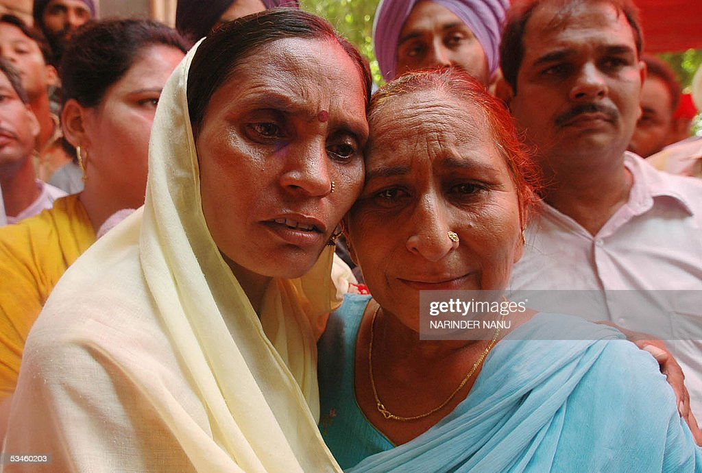 Dalbir Kaur the sister of imprisoned Sarabjit Singh hugs Sukhpreet Kaur the wife of Sarabjit Singh after their meeting political leaders from Delhi...