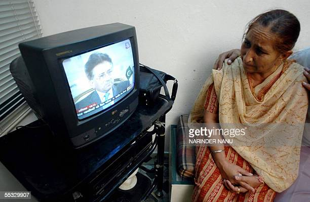 Dalbir Kaur the sister of Indian national Sarabjit Singh currently in jail in Pakistan is comforted by a relative at her home in Amritsar 10...