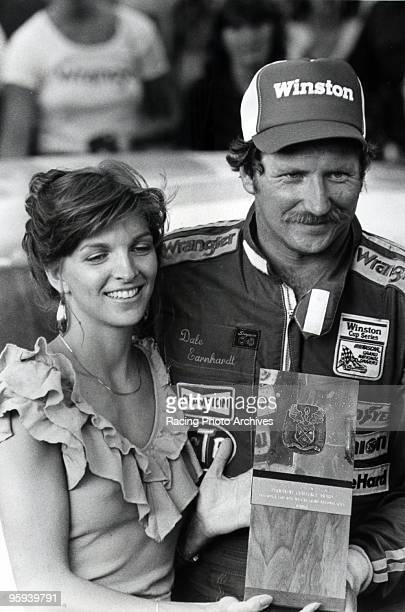 Dale and Teresa Earnhardt celebrate the victory at the Talladega 500 Earnhardt would win by one car lenght and take home $46950 for the race