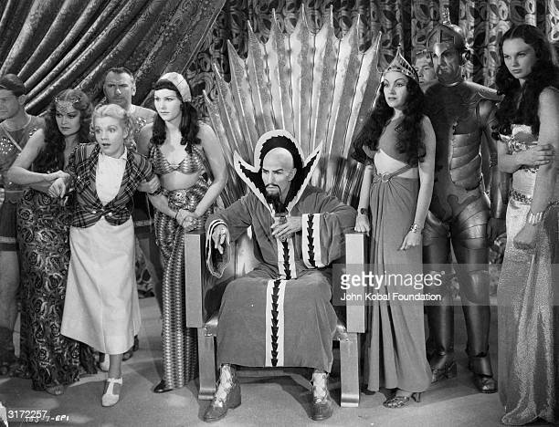 Dale Arden struggles in the grip of two servants of Ming the Merciless and his daughter Princess Aura in a scene from episode one of the scifi...