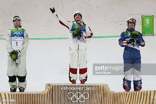 Dale Begg-Smith of Australia celebrates winning silver, Alexandre Bilodeau of Canada gold and Bryon Wilson of United States bronze during the flower...
