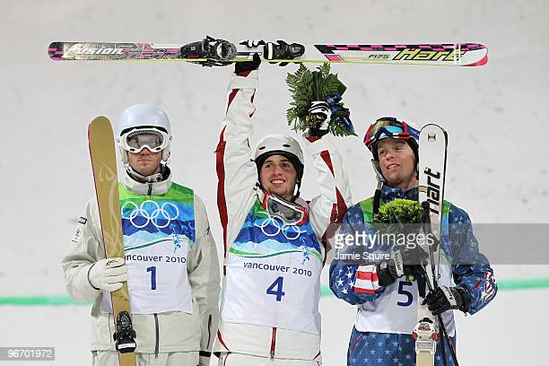Dale BeggSmith of Australia celebrates winning silver Alexandre Bilodeau of Canada gold and Bryon Wilson of United States bronze during the flower...