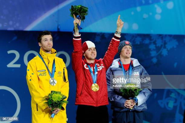 Dale BeggSmith of Australia celebrates winning silver Alexandre Bilodeau of Canada poses with the gold and Bryon Wilson of the United States poses...