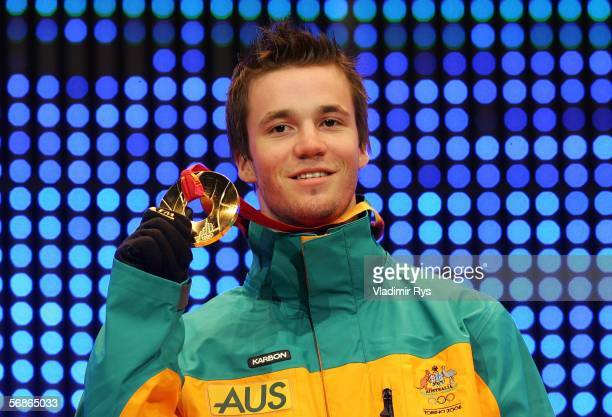 Dale BeggSmith of Australia presents his gold medal during the Medals Ceremony during Turin 2006 Winter Olympic Games on February 16 2006 at the...