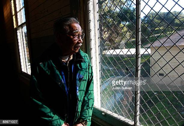 Dale Ching who was detained for three and a half months at the Angel Island Immigration Station in 1937 looks out a window while touring the...