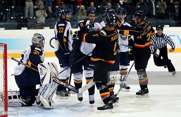 Dale Clarke of Espoo fights with Patrik Bartschi of Bern during the IIHF Champions Hockey League match between SC Bern and Espoo Blues at the...