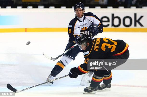 Dale Clarke of Espoo in action with Ivo Ruthemann of Bern during the IIHF Champions Hockey League match between SC Bern and Espoo Blues at the...