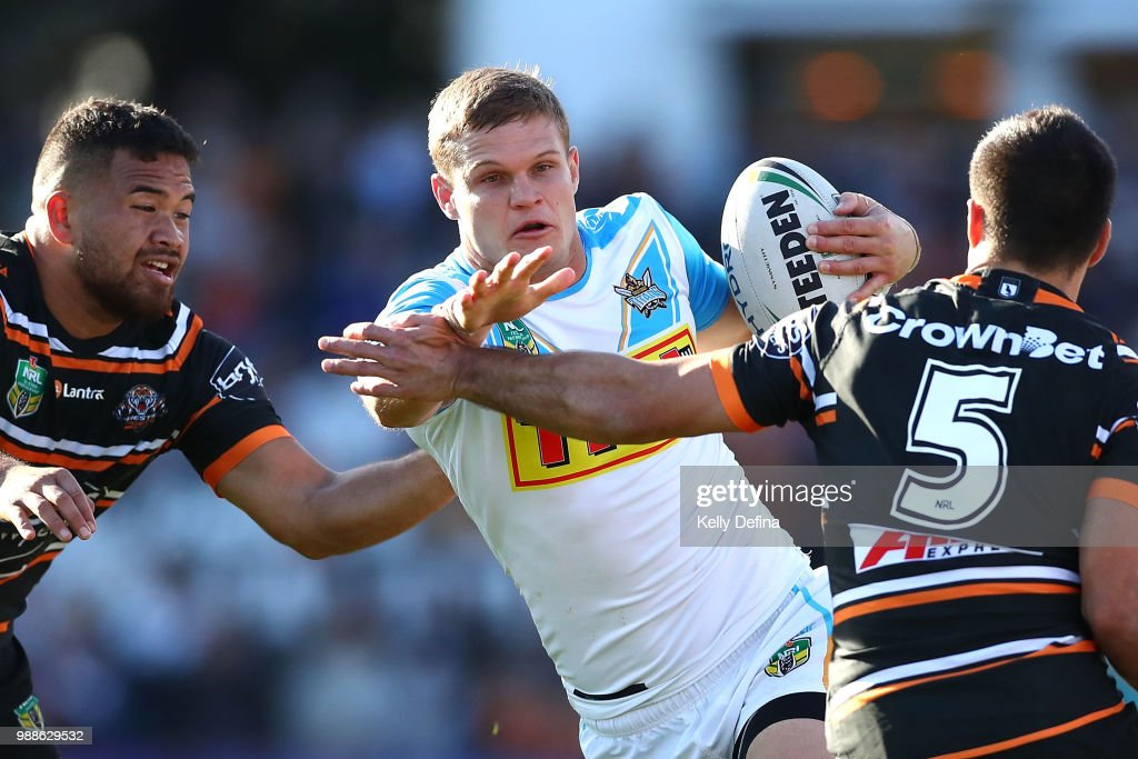 Dale Copley of the Titans is tackled by Tigers defense during the round 16 NRL match between the Wests Tigers and the Gold Coast Titans at Leichhardt Oval on July 1, 2018 in Sydney, Australia.