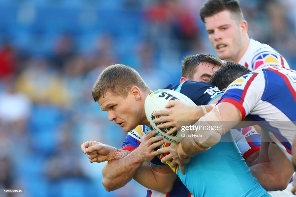 Dale Copley of the Titans is tackled during the round 11 NRL match between the Gold Coast Titans and the Newcastle Knights at Cbus Super Stadium on May 19, 2018 in Gold Coast, Australia.