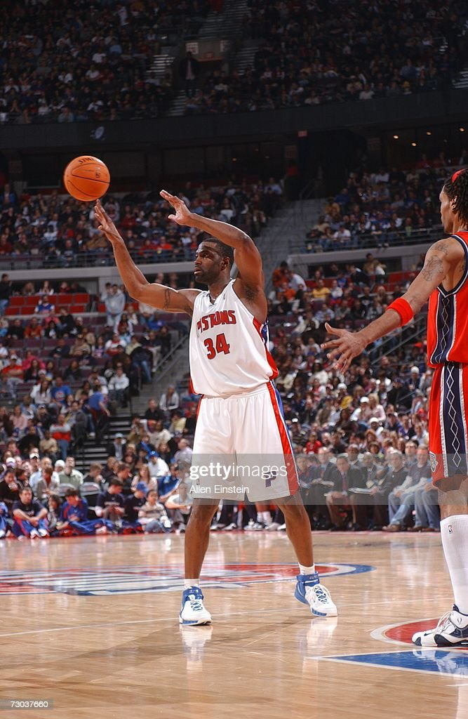 Dale Davis #34 of the Detroit Pistons looks to pass during a game against the New Jersey Nets at the Palace of Auburn Hills on December 26, 2006 in Auburn Hills, Michigan. The Pistons defeated the Nets 92-91.