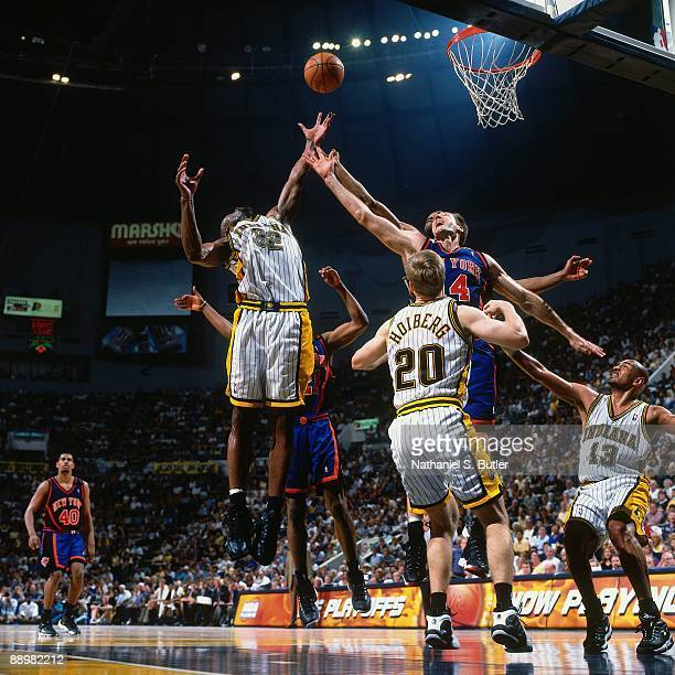 Dale Davis of the Indiana Pacers and Chris Dudley of the New York Knicks battle for a rebound in Game Five of the Eastern Conference Finals during...