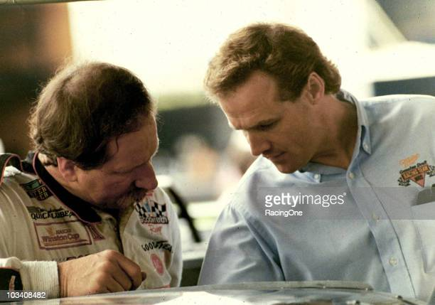 Dale Earnhardt and Rusty Wallace in deep conversation at a NASCAR Cup race at Talladega Superspeedway