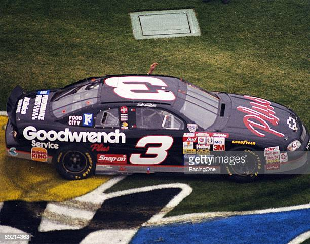 Dale Earnhardt celebrates after winning the Daytona 500