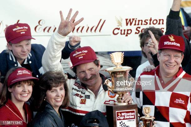 Dale Earnhardt celebrates his 4th NASCAR Winston Cup Championship with son Dale Earnhardt Jr top left after the Atlanta Journal 500 NASCAR Winston...