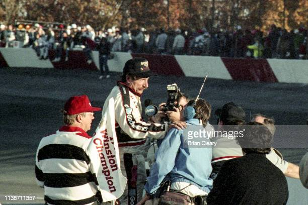 Dale Earnhardt celebrates his 4th NASCAR Winston Cup Championship after the Atlanta Journal 500 NASCAR Winston Cup race Atlanta Motor Speedway on...