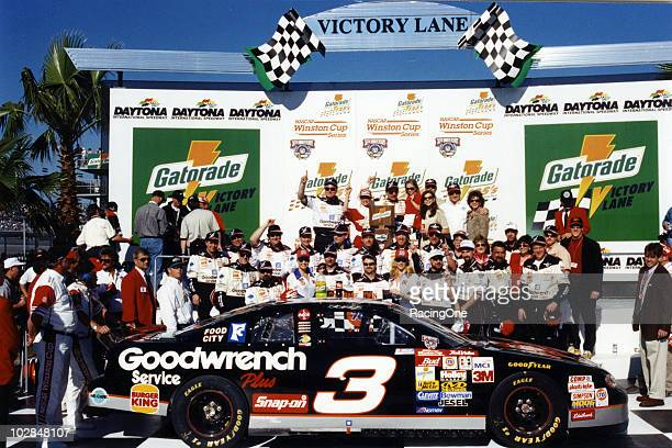 Dale Earnhardt celebrates his win in one of the twin Gatorade 125 qualifying races for the Daytona 500 NASCAR Cup race at Daytona International...