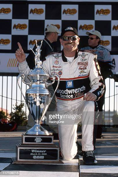 Dale Earnhardt celebrates in victory lane after winning the Cracker Barrel Old Country Store 500 NASCAR Cup race at Atlanta Motor Speedway