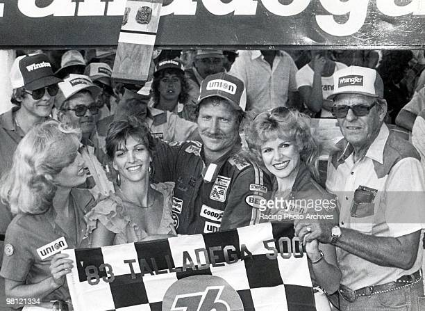 Dale Earnhardt celebrates in Victory Lane with wife Teresa car owner Bud Moore and the Winston Cup girls Earnhardt would take home $46950 for the...