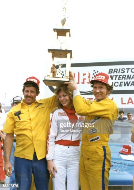 Dale Earnhardt celebrates with crew chief Jake Elder in Victory Lane after his first Winston Cup win on April 1 1979 at the Bristol International...