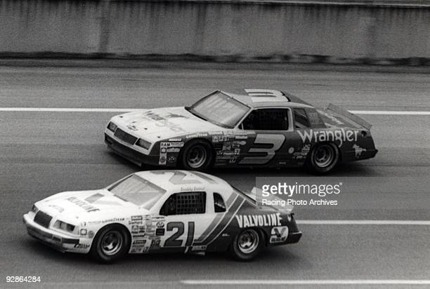 Dale Earnhardt fighting it out with Buddy Baker to the finish line Earnhardt won by 166 seconds to take home $47100 for the Talladega 500