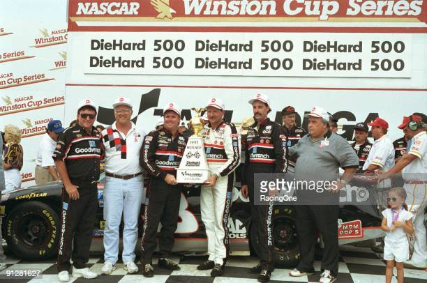Dale Earnhardt in victory lane after winning the 1993 DieHard 500 by 0005 seconds over Ernie Irvan giving him his sixth win of the year He would go...