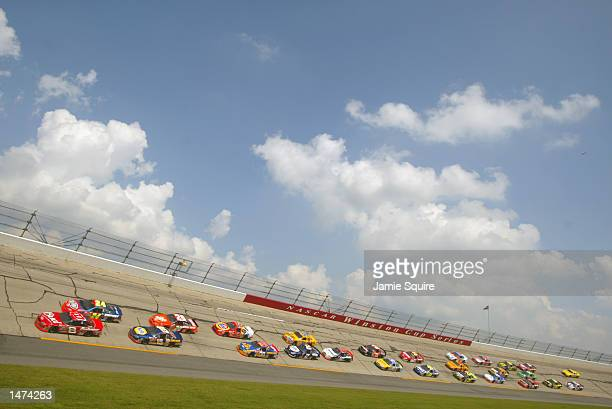 Dale Earnhardt Jr #8 and Jeff Gordon lead the field during the NASCAR Winston Cup EA Sports 500 at Talladega Superspeedway on October 6 2002 in...