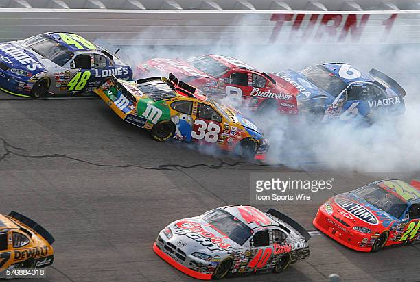 Dale Earnhardt Jr and Elliott Sadler tangle in an early wreck in the UAW Ford 500 NASCAR race at the Talladega Super Speedway in Talladega Alabama