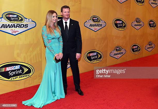 Dale Earnhardt Jr and his girlfriend Amy Reimann arrive at the 2014 NASCAR Sprint Cup Series Awards at Wynn Las Vegas on December 5 2014 in Las Vegas...