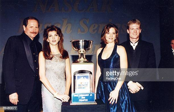Dale Earnhardt Jr and his proud father Dale Sr pose for photos after Junior received the NASCAR Busch Series Championship Cup in New York New York in...