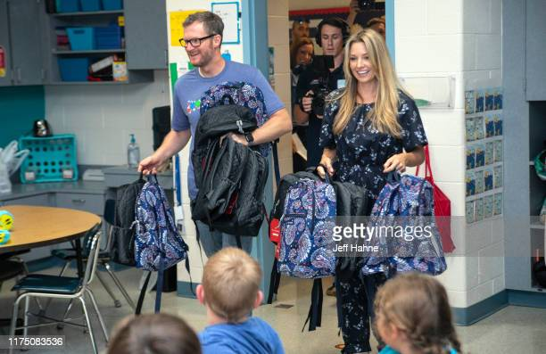 Dale Earnhardt Jr and his wife Amy surprised students for the Vera Bradley x Blessings In A Backpack Event at Shepherd Elementary on September 16...