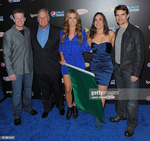 Dale Earnhardt Jr Audrina Patridge and Jeff Gordon arrive at the Auto Club Speedway's Pepsi 500 held at The Roosevelt Hotel on October 7 2009 in...