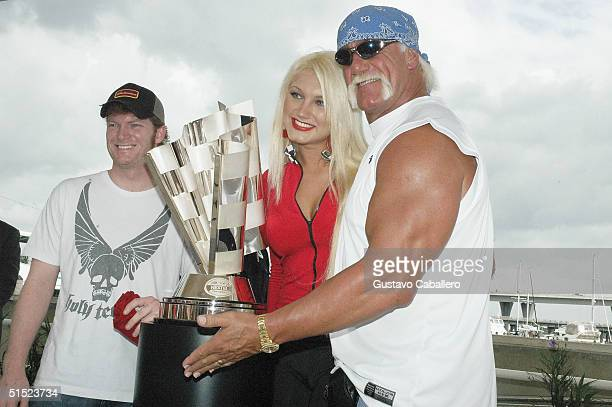 Dale Earnhardt Jr Brooke Hogan and her father Hulk Hogan attend Dale Earnhardt Jr Day at Bayside Market Place on October 20 2004 in Miami Florida