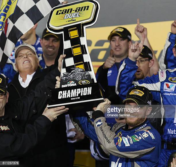 Dale Earnhardt Jr celebrates after winning the first of twin qualifying races for the Daytona 500 at Daytona International Speedway on Thursday Feb...