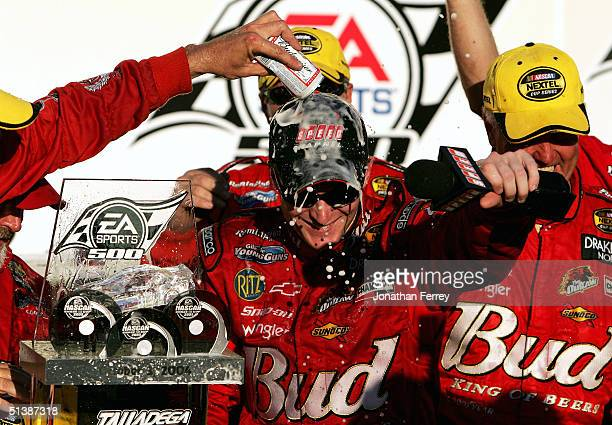 Dale Earnhardt Jr celebrates in victory lane after winning the NASCAR Nextel Cup EA Sports 500 on October 3 2004 at Talladega Superspeedway in...