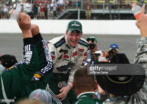 Dale Earnhardt Jr celebrates with his crew in victory lane after winning the NASCAR Sprint Cup Series Lifelock 400 at the Michigan International...