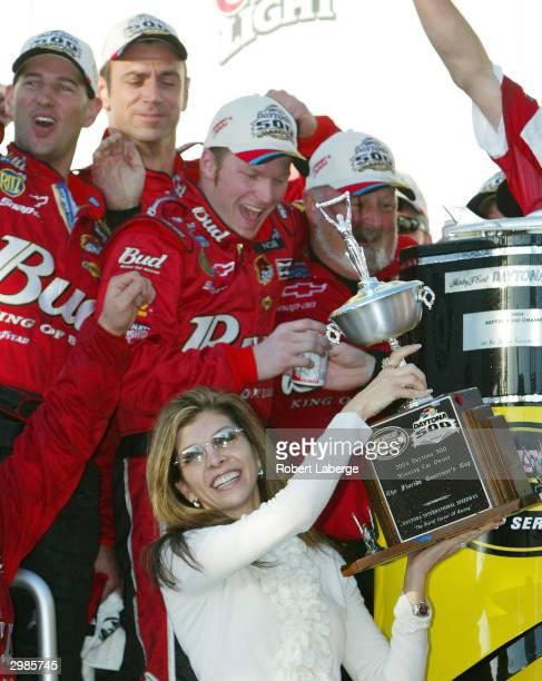 Dale Earnhardt Jr celebrates with his stepmother Teresa Earnhardt the widow of Dale Earnhardt after winning the NASCAR Nextel Cup Daytona 500 on...