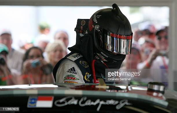 Dale Earnhardt Jr., climbs into his National Guard Serving America/AMP Energy Chevrolet car for NASCAR Sprint Cup Series practice at Daytona...