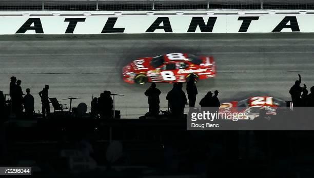 Dale Earnhardt Jr., driver Budweiser Chevrolet leads Ken Schrader, driver of Little Debbie Ford during the NASCAR Nextel Cup Series Bass Pro Shops...