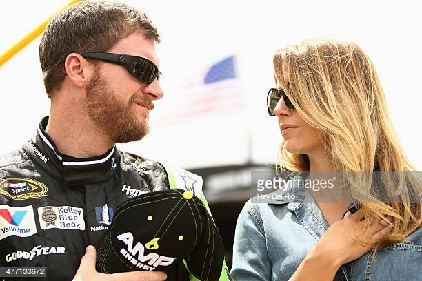 Dale Earnhardt Jr driver of the AMP ENERGY Chevrolet and his girlfriend Amy Reimann stand for the national anthem prior to the NASCAR Sprint Cup...